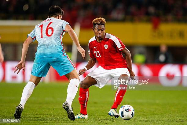 Ozan Tufan of Turkey competes for the ball with David Alaba of Austria during the international friendly match between Austria and Turkey at...