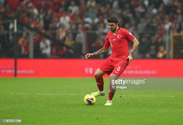 Ozan Tufan of Turkey controls the ball during the UEFA Euro 2020 qualifier between Turkey and Iceland at Ali Sami Yen Arena on November 14 2019 in...