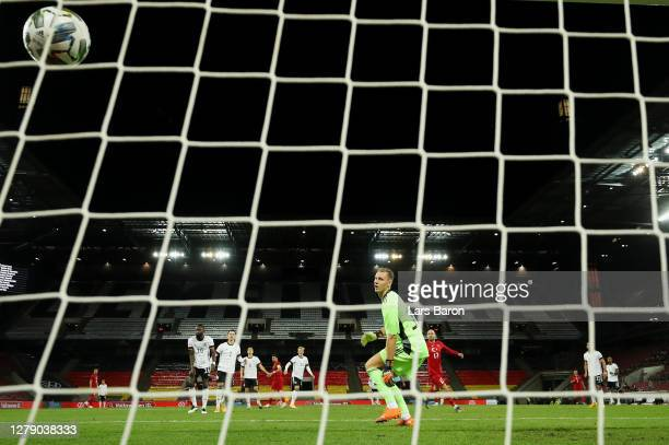 Ozan Tufan of Turkey scores his team's first goal past Goalkeeper Bernd Leno of Germany during the international friendly match between Germany and...