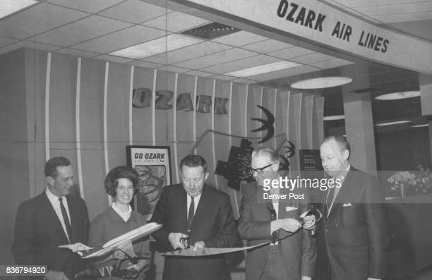 Ozark Air Lines Personnel Open Facility Robert Knight Ozark district sales manager and Mary Ellen Zimmerman ground hostess St Louis Mo participate in...