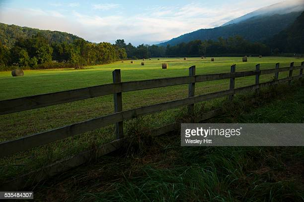 ozark mountain valley with hay bales - ozark mountains stock pictures, royalty-free photos & images