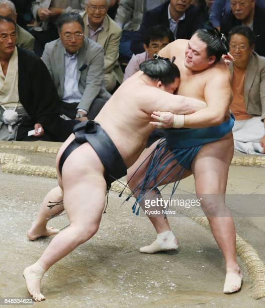 Ozeki Goeido forces komusubi Tamawashi out of the dohyo ring during the eighth day of the Autumn Grand Sumo Tournament at Ryogoku Kokugikan in Tokyo...