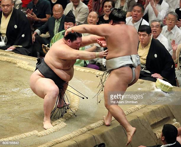 Ozeki Goeido pushes Mongolian wrestler Takanoiwa to win during day four of the Grand Sumo Autumn Tournament at Ryogoku Kokugikan on September 14 2016...