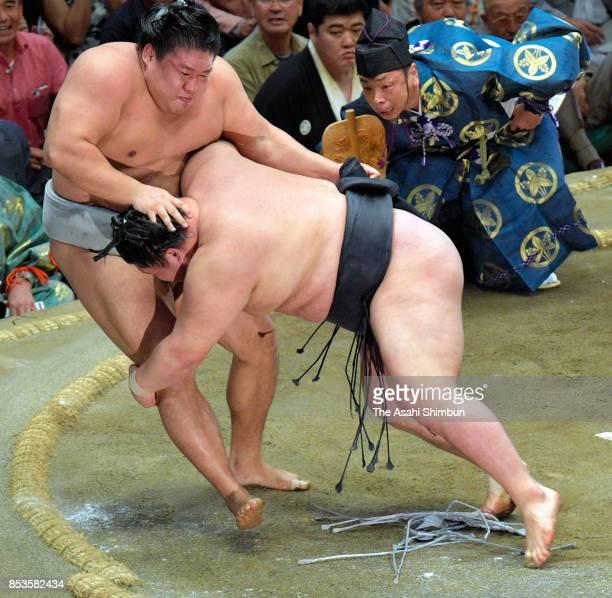 Ozeki Goeido throws Mongolian wrestler Takanoiwa to win during day fourteen of the Grand Sumo Autumn Tournament at Ryogoku Kokugikan on September 23...