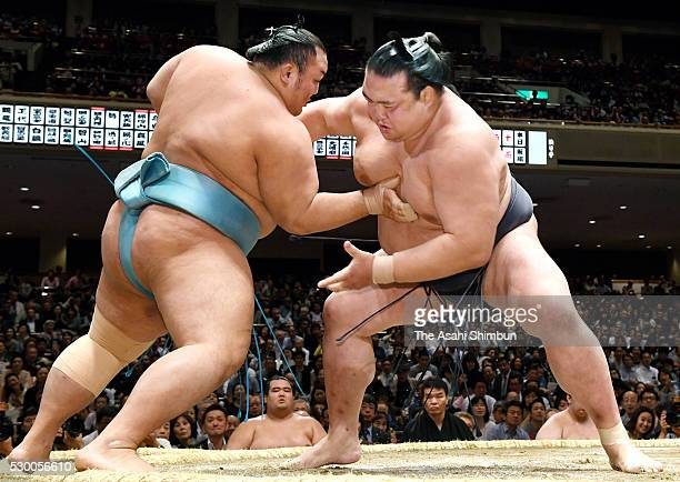 Ozeki Kisenosato pushes Kotoyuki out of the ring to win during day two of the Grand Sumo Summer Tournament at Ryogoku Kokugikan on May 9 2016 in...