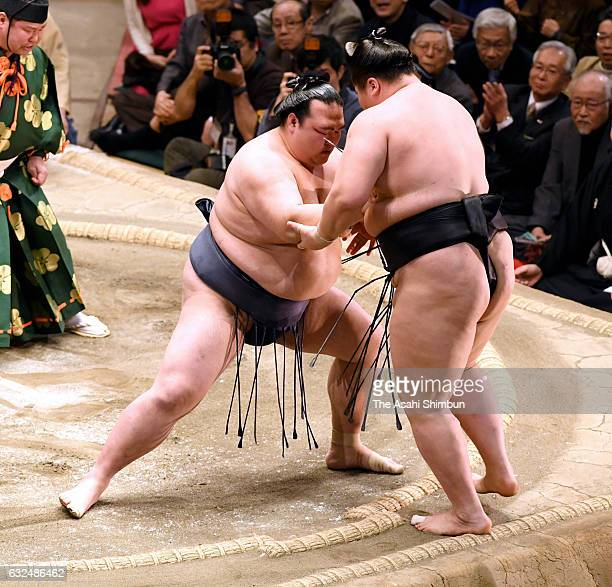 Ozeki Kisenosato pushes Mongolian ozeki Terunofuji out of the ring to win during day fourteen of the Grand Sumo New Year Tournament at Ryogoku...