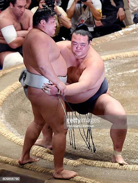 Ozeki Kisenosato pushes Mongolian wrestler Takanoiwa out of the ring to win during day five of the Grand Sumo Autumn Tournament at Ryogoku Kokugikan...