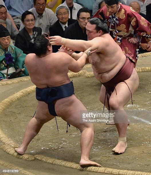 Ozeki Kisenosato pushes Mongolian yokozuna Kakuryu to win during day fifteen of the Grand Sumo Summer Tournament at Ryogoku Kokugikan on May 25 2014...