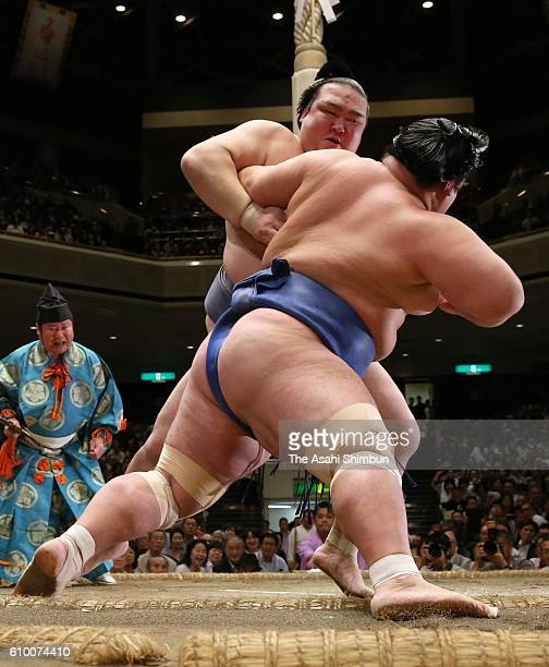 Ozeki Kisenosato throws ozeki Kotoshogiku to win during day ten of the Grand Sumo Autumn Tournament at Ryogoku Kokugikan on September 20 2016 in...