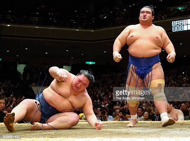 Ozeki Kotoshogiku celebrates winning the tournament after beating Goeido during day fifteen of the Grand Sumo New Year Tournament at Ryogoku...