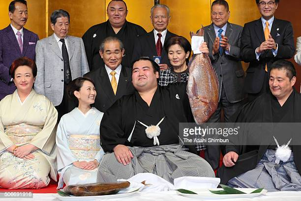 Ozeki Kotoshogiku holds red snapper to celebrate after winning the tournament during day fifteen of the Grand Sumo New Year Tournament on January 24...