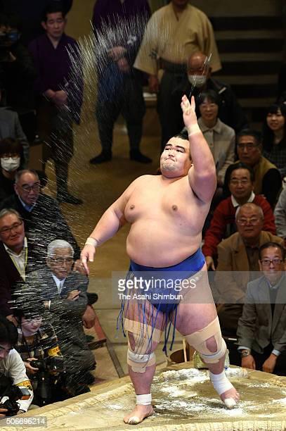 Ozeki Kotoshogiku sprays salts as a preparation for his bout during day fourteen of the Grand Sumo New Year Tournament at Ryogoku Kokugikan on...