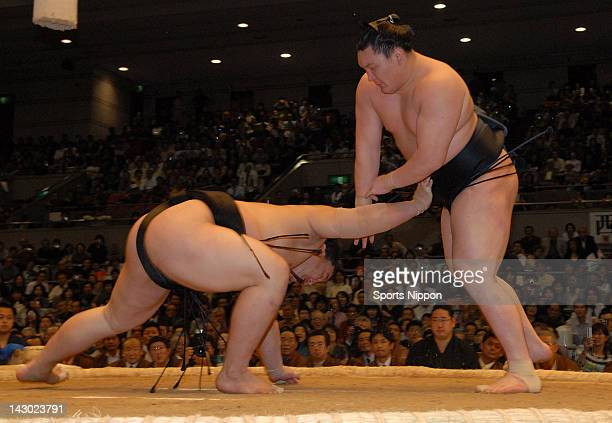 Ozeki second highest rank in sumo Hakuho throws Asashoryu to win the Grand Sumo Spring Tournament at Osaka Prefectural Gymnasium on March 25 2007 in...
