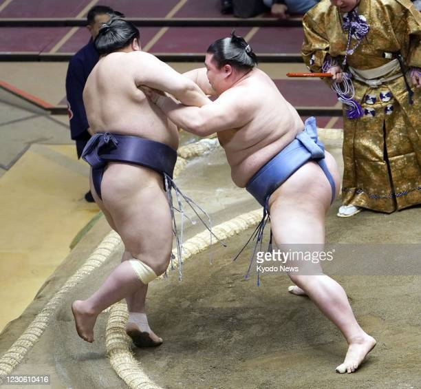 Ozeki Shodai defeats Onosho on the seventh day of the New Year Grand Sumo Tournament at Ryogoku Kokugikan in Tokyo on Jan. 16, 2021.