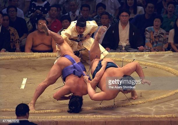 Ozeki Takanonami throws Mainoumi to win during the Grand Sumo Nagoya Tournament at Aichi Prefecture Gymnasium on July 13 1994 in Nagoya Aichi Japan