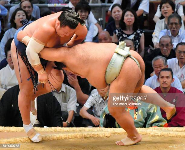 Ozeki Takayasu pushes Ikioi out of the ring to win during day two of the Grand Sumo Nagoya Torunament at Aichi Prefecture Gymnasium on July 10 2017...