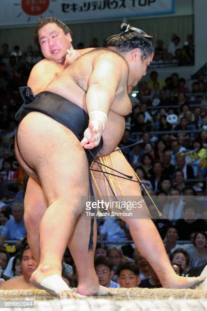 Asahiyama and Bulgarian wrestler Aoiyama compete on day eight of the Grand Sumo Nagoya Tournament at the Dolphin's Arena on July 15 2018 in Nagoya...