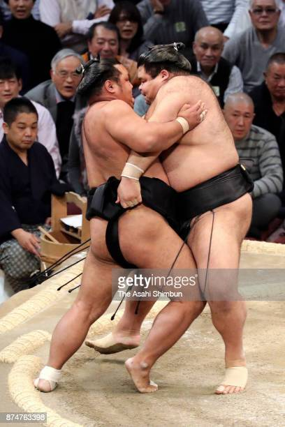 Ozeki Takayasu pushes Shohozan out of the ring to win during day four of the Grand Sumo Kyushu Tournament at Fukuoka Convention Center on November 15...