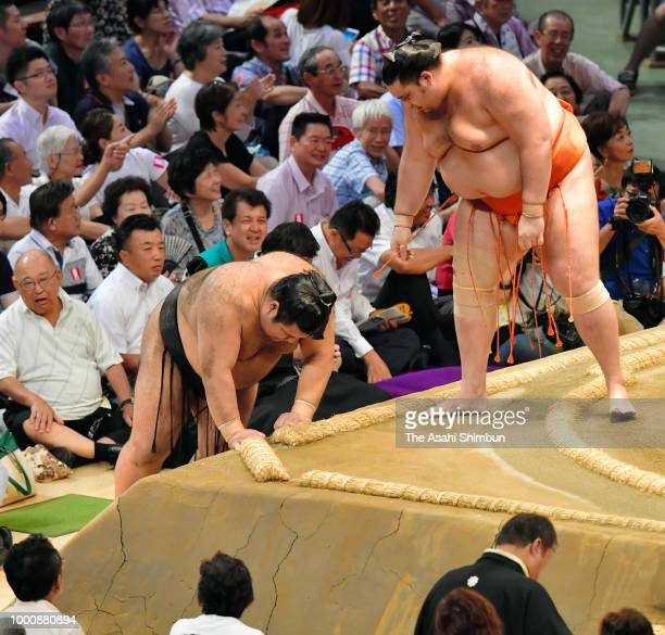 Hokutofuji and Asanoyama compete on day ten of the Grand Sumo Nagoya Tournament at the Dolphin's Arena on July 17 2018 in Nagoya Aichi Japan