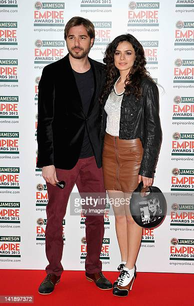 Ozge Ozipinric and Engin Altan Duzyatan attend the 2012 Jameson Empire Awards at the Grosvenor House Hotel on March 25 2012 in London England...