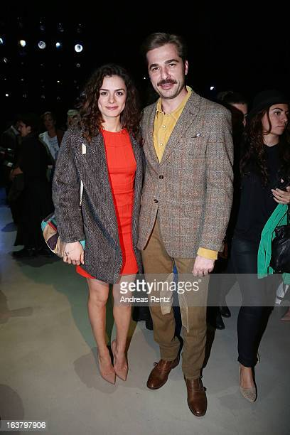 Ozge Ozpirincci and Engin Altan Duzyatan attend the Soul By Ozgur Masur show during Mercedes Benz Fashion Week Istanbul Fall/Winter 2013/14 at...