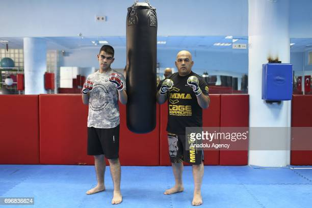Ozlen Alkac an MMA fighter poses for a photo with his 17yearold MMA fighter son Alim Can Alkac who had chosen the same field of profession with his...
