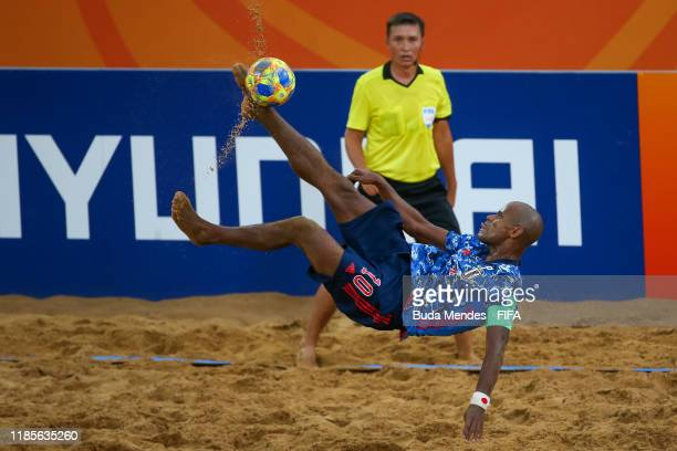 Ozu Moreira of Japan attempts a bicycle kick during the FIFA Beach Soccer World Cup Paraguay 2019 semi final match between Japan and Portugal at...