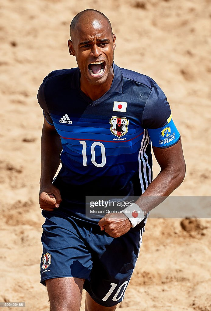 Ozu Moreira of Japan celebrates scoring during the Continental Beach Soccer Tournament match between Japan and Vietnam at Municipal Sports Center on August 25, 2016 in Ordos of Inner Mongolia Autonomous Region, China.
