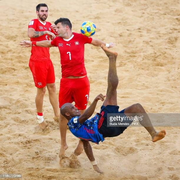 Ozu Moreira of Japan is challenged by Sandro Spaccarotella of Switzerland during the FIFA Beach Soccer World Cup Paraguay 2019 group A match between...