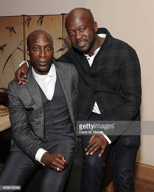Ozwald Boateng and David Adjaye attends the STANDSEVEN party hosted by David Adjaye and Ross Lovegrove at The Club at Cafe Royal on September 17 2014...