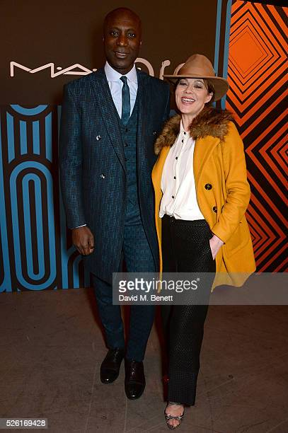 Ozwald Boateng and Helen McCrory attend the MAC Pro to Pro Textile Party at London's Camden Roundhouse on April 29 2016 in London England