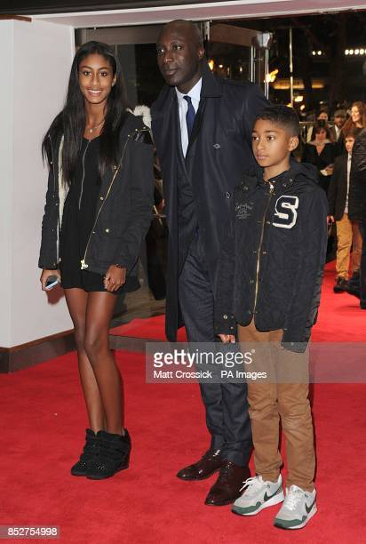 Ozwald Boateng and his children Emilia and Oscar arriving for the World Premiere of The Hunger Games Catching Fire at the Odeon Leicester Square...