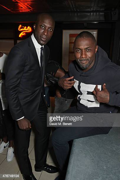 Ozwald Boateng and Idris Elba attend the official Idris Elba Superdry presentation at LCM at Hix on June 11 2015 in London England