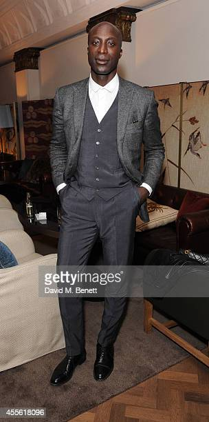 Ozwald Boateng attends the STANDSEVEN party hosted by David Adjaye and Ross Lovegrove at The Club at Cafe Royal on September 17 2014 in London England