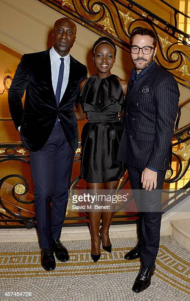 Ozwald Boateng Lupita Nyong'o and Jeremy Piven attend the Sindika Dokolo Art Foundation dinner at Cafe Royal on October 18 2014 in London England