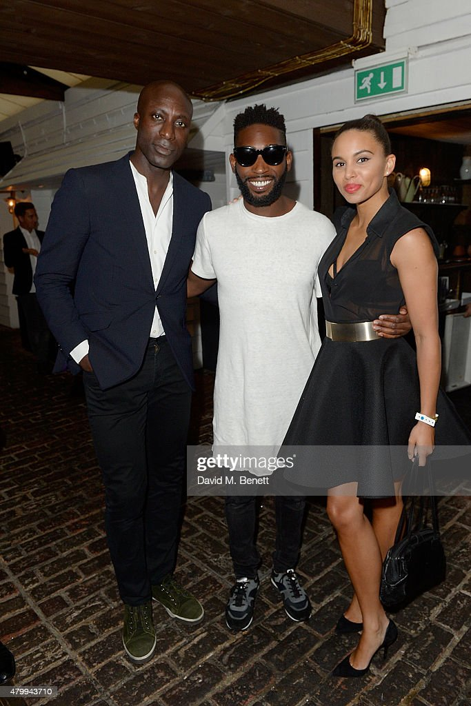 Ozwald Boateng, Tinie Tempah and Louise Hazel attend the Warner Summer Party in association with British GQ at Shoreditch House on July 8, 2015 in London, England.