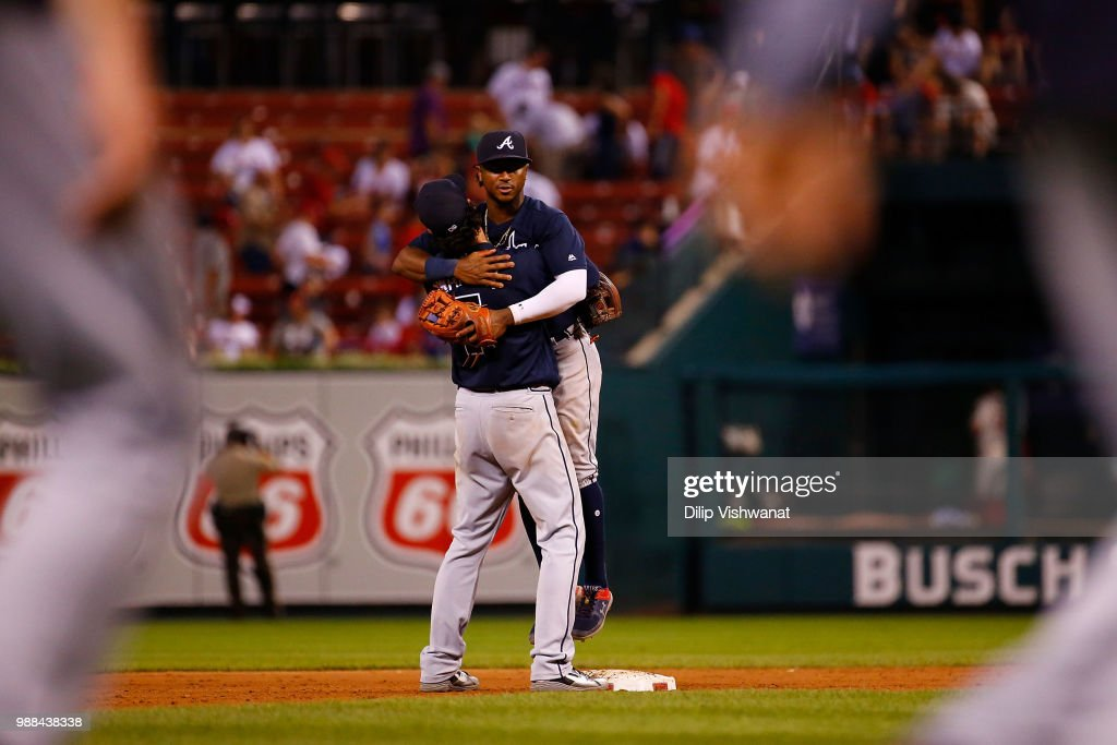 Ozzie Albies #1 and Dansby Swanson #7 of the Atlanta Braves celebrate after vbeating the St. Louis Cardinals at Busch Stadium on June 30, 2018 in St. Louis, Missouri.