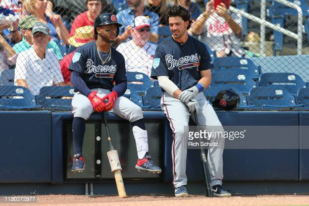 Ozzie Albies and Dansby Swanson of the Atlanta Braves wait for a spring training baseball game against the Washington Nationals to begin at Fitteam...
