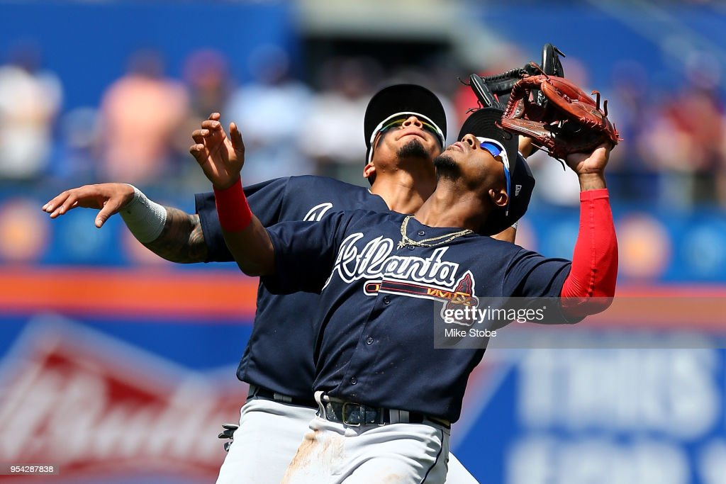 Ozzie Albies #1 and Johan Camargo #17 of the Atlanta Braves collide attempting to catch a pop fly off the bat of Jose Reyes #7 of the New York Mets in the first inning at Citi Field on May 3, 2018 in the Flushing neighborhood of the Queens borough of New York City.