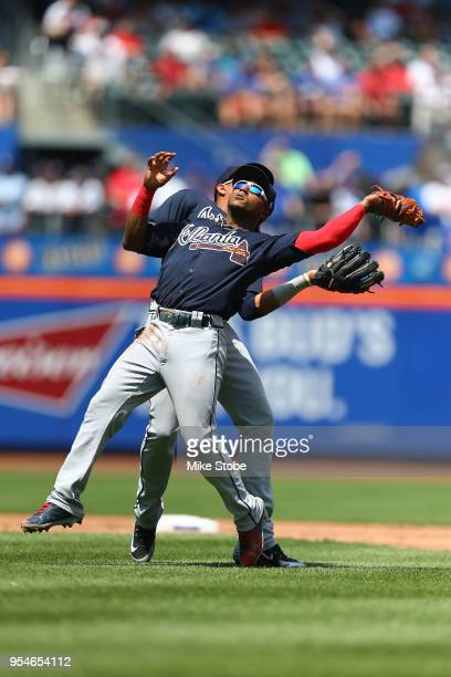 Ozzie Albies and Johan Camargo of the Atlanta Braves collide attempting to catch a pop fly off the bat of Jose Reyes of the New York Mets in the...