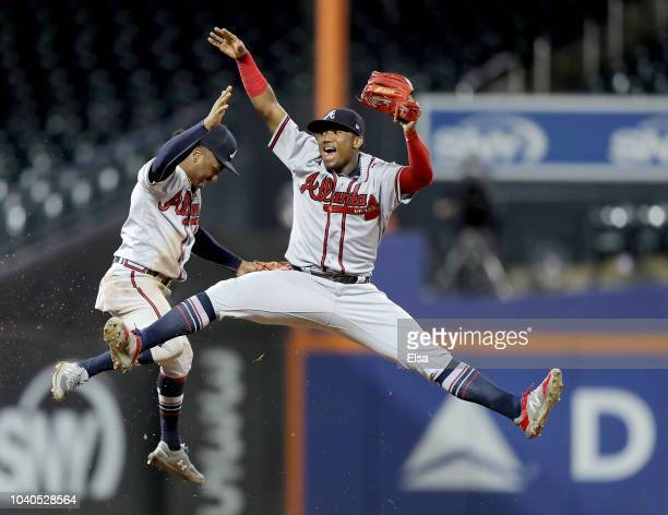 Ozzie Albies and Ronald Acuna Jr #13 of the Atlanta Braves celebrate the 73 win over the New York Mets on September 252018 at Citi Field in the...
