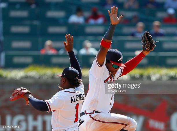 Ozzie Albies and Ronald Acuna Jr #13 of the Atlanta Braves celebrate after their 54 win over the Philadelphia Phillies at SunTrust Park on September...