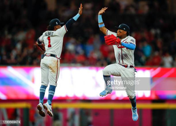 Ozzie Albies and Ronald Acuna Jr. #13 of the Atlanta Braves react at the conclusion of game two of a doubleheader against the St. Louis Cardinals at...