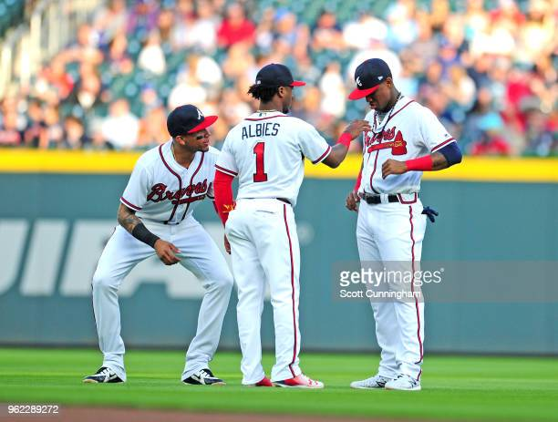 Ozzie Albies Johan Camargo and Ronald Acuna Jr #13 of the Atlanta Braves warm up prior to the game against the San Francisco Giants at SunTrust Park...