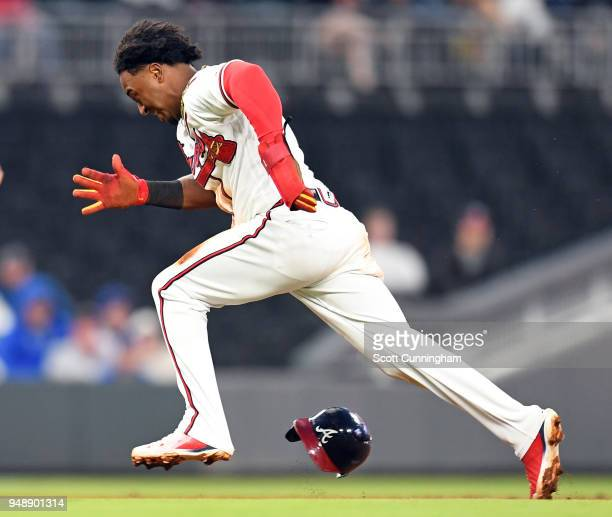 Ozzie Albies of the Atlanta Braves advances to third base in the first inning against the New York Mets at SunTrust Park on April 19 2018 in Atlanta...
