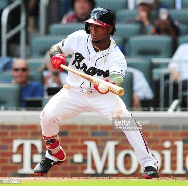 Ozzie Albies of the Atlanta Braves bunts for a base hit during the eighth inning against the New York Mets at SunTrust Field on May 28 2018 in...