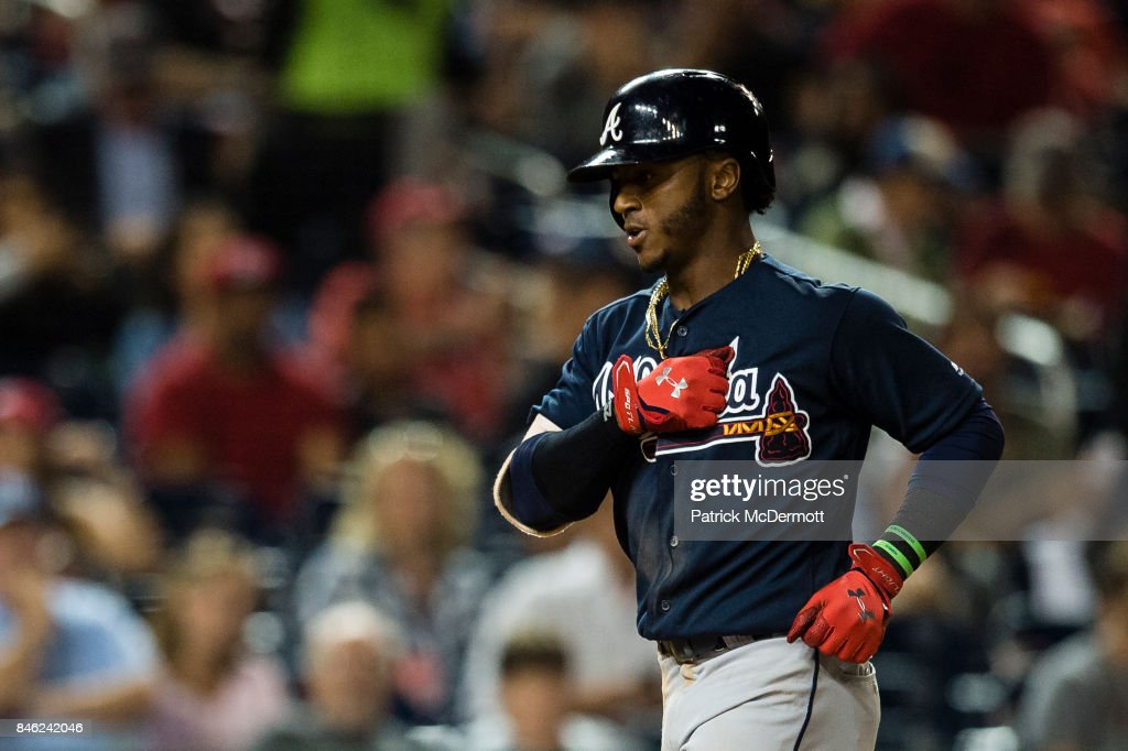 Ozzie Albies #1 of the Atlanta Braves celebrates after hitting a solo home run in the seventh inning against the Washington Nationals at Nationals Park on September 12, 2017 in Washington, DC.