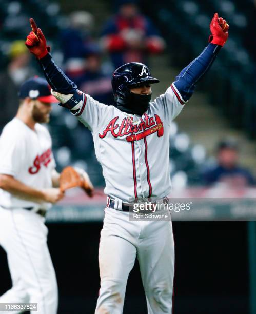 Ozzie Albies of the Atlanta Braves celebrates after scoriing on Ronald Acuna Jr #13 double off Cody Anderson of the Cleveland Indians during the...