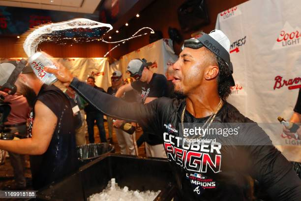 Ozzie Albies of the Atlanta Braves celebrates in the clubhouse with beer at the conclusion of an MLB game against the San Francisco Giants in which...
