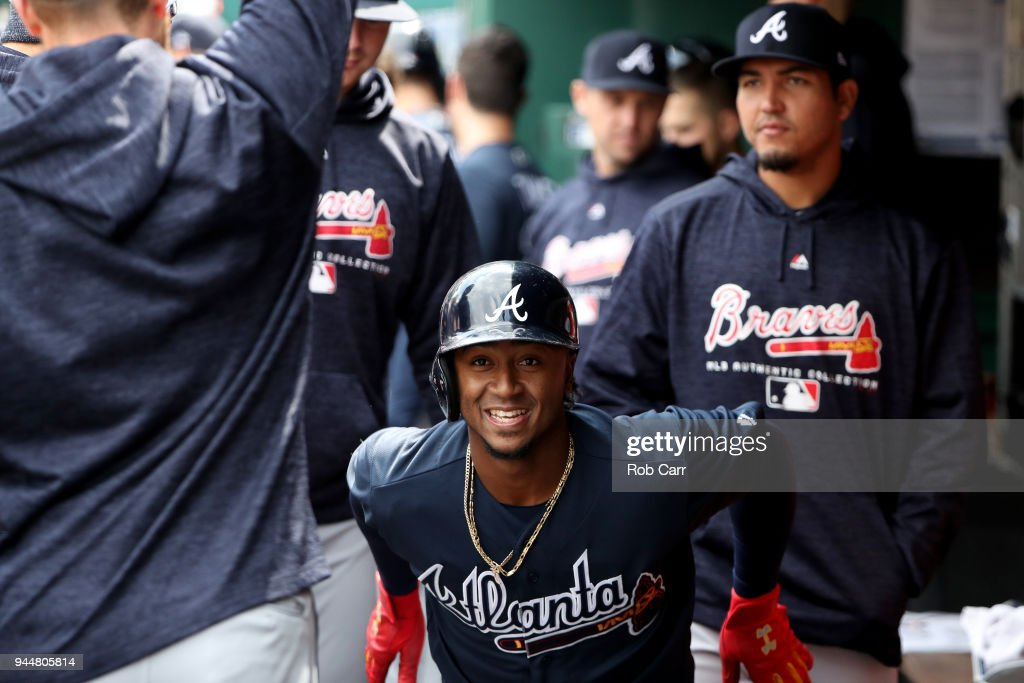 Ozzie Albies #1 of the Atlanta Braves celebrates in the dugout after hitting a solo home run against the Washington Nationals in the first inning at Nationals Park on April 11, 2018 in Washington, DC.